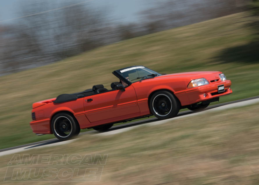 Convertible Foxbody Mustang Cruising Down the Road