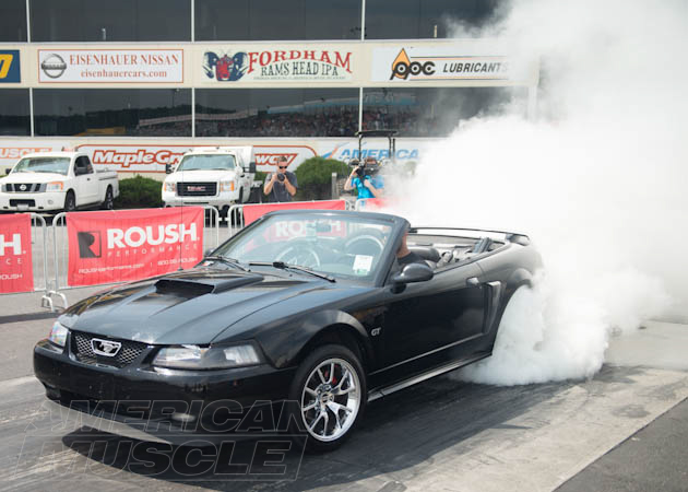 Black SN95 Mustang Doing a Burn Out