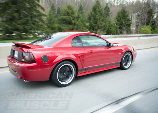 Red SN95 1999-2004 Mustang on the Road