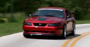 2000-2004 Mustang Cruising Down the Road
