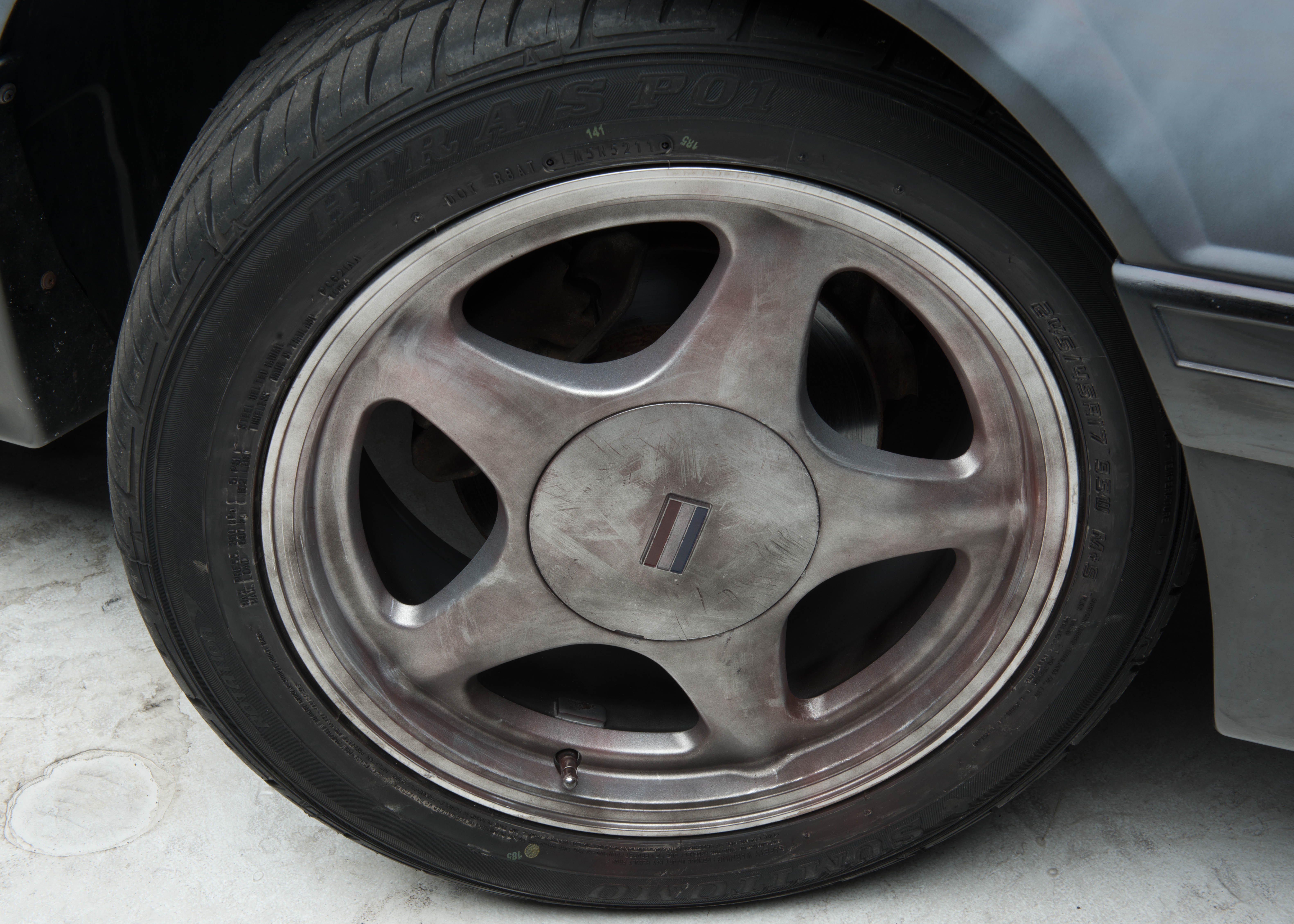 Foxbody with an Old Tire and a Dirty Rim