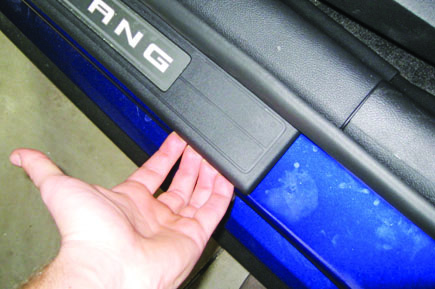 The Sill Panel Is Secured To The Vehicle With Two (2) Clips And A Strip Of  Double Sided Tape. Disengage The Clips By Firmly Pulling Upward At Each End  Of ...