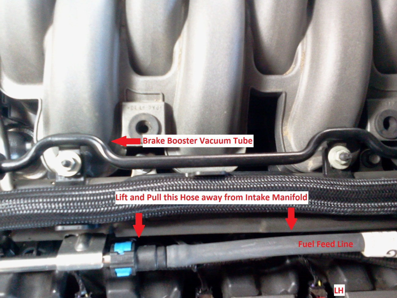 How To Install A Boss 302 Intake Manifold On Your 2011 2013 Mustang 2000 Ford Purge Valve Location Underneath You Will See 2 Nuts Holding Plastic Hose Brackets Use 10mm Socket Remove Them And Set Aside The