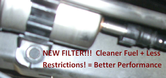 reinstall the fuel filter strap to the vehicle's chassis and reinstall  cover in reverse order of removal
