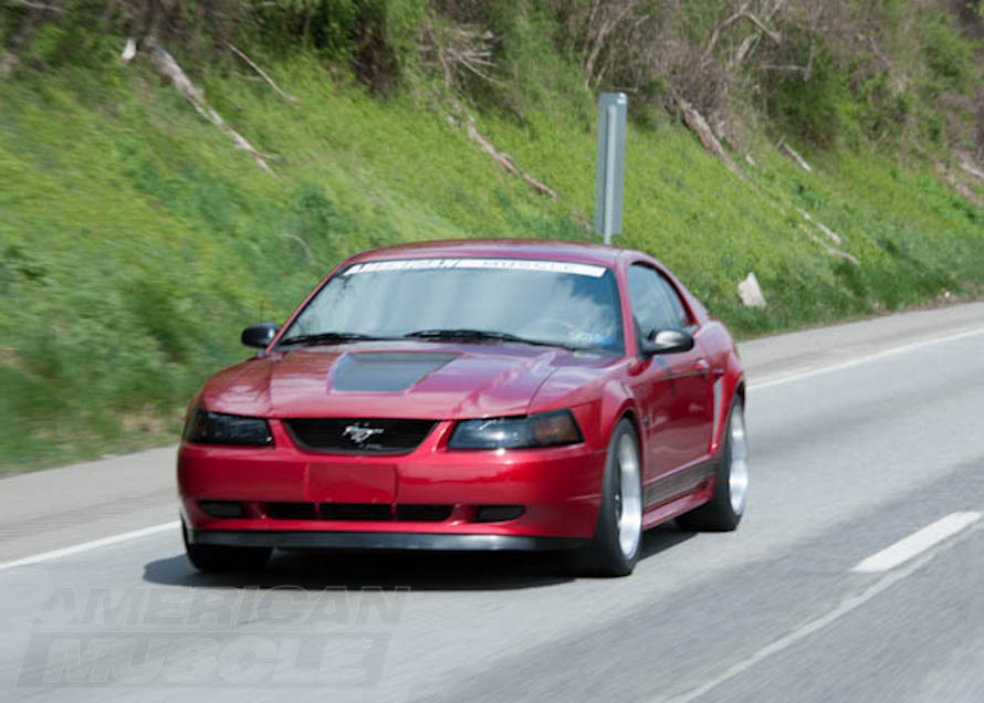 New Edge Mustang Cruising Down the Road