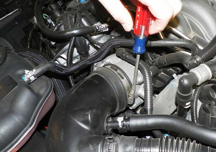 Part 2 Remove the vacuum hose connecting the valve cover to the stock black air inlet tube. On the fitting that attaches the hose to the air intake tube ... & How to Install a Cu0026L Cold Air Intake on Your 2011-2012 GT Mustang ...