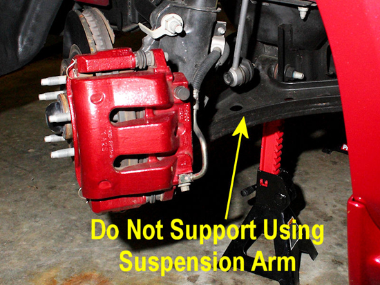 Next Raise The Rear Of The Vehicle And Support It With Jack Stands Paced In Front Of The Rear Axle Close To The Side Jacking Points