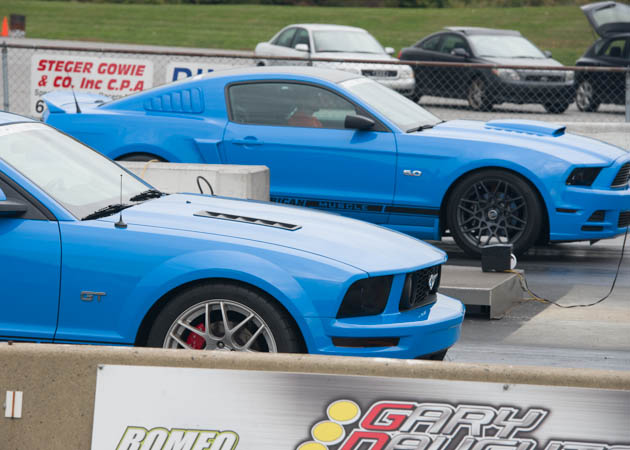 2014 Mustang and a 2006 GT Lined Up at the Drag Strip