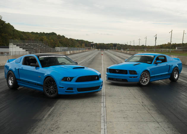 A 2014 GT and a 2006 GT Mustangs at the Drag Strip