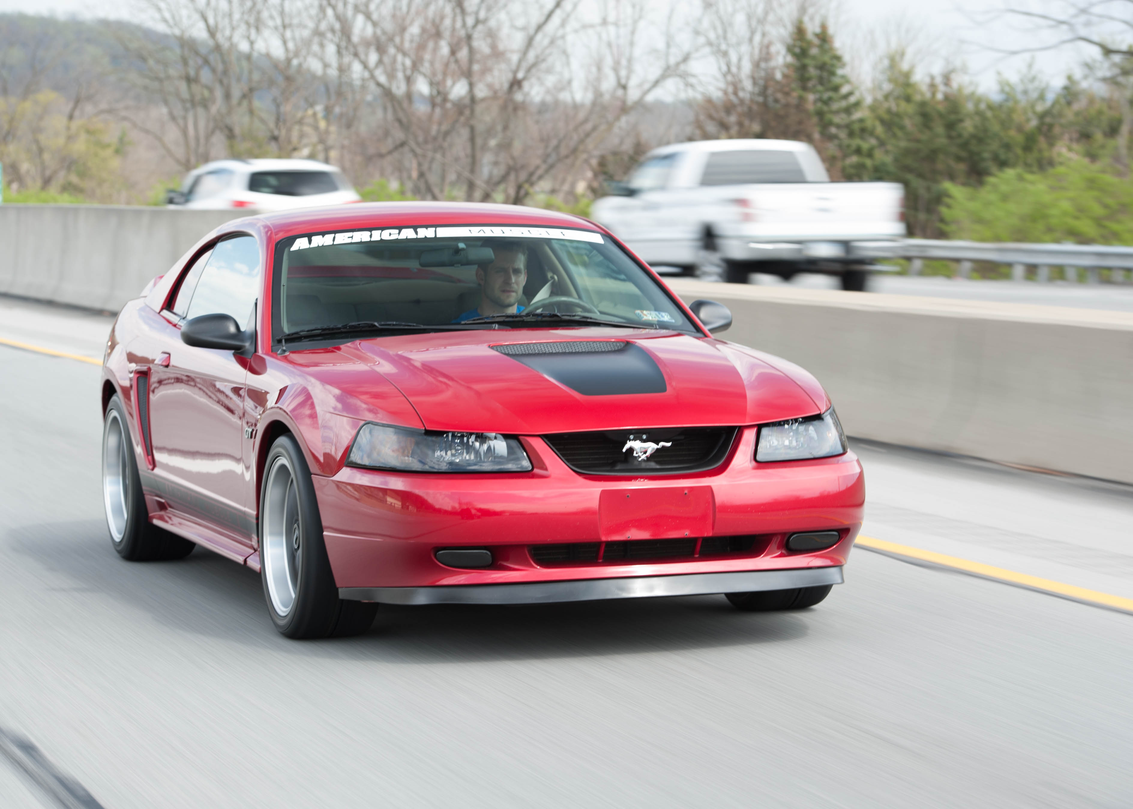 1999-2004 Mustang Cruising Down the Highway