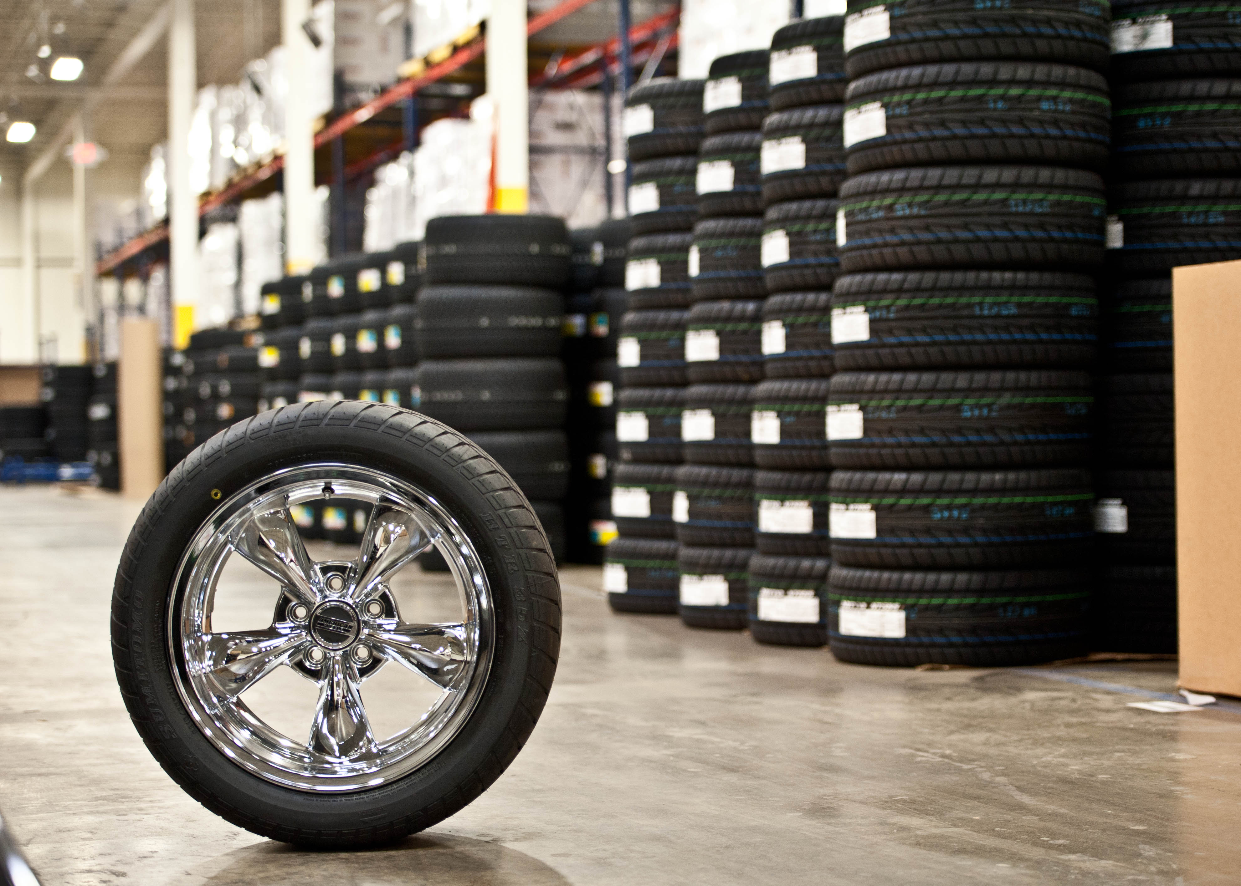 AmericanMuscle Chrome Wheel with Mounted Tire Waiting in the Warehouse